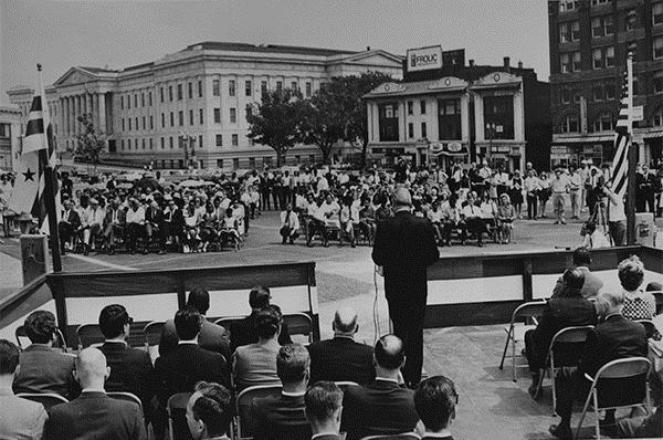Deputy Mayor Thomas Fletcher as master of ceremonies on the site of MLK Library in 1968.