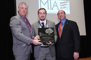 2015 MIA President Dan Rea of Coldspring, sponsor of the 2014 Scholarship Award and 2014 MIA President Tony Malisani of Malisani, Inc. presenting the 2014 MIA Natural Stone Scholarship Award to Stephen Beck of Connecticut Stone Supplies, Inc. in Milford, Conn.