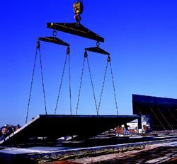 The crane should be able to lift the heaviest panel plus the weight of the rigging gear.