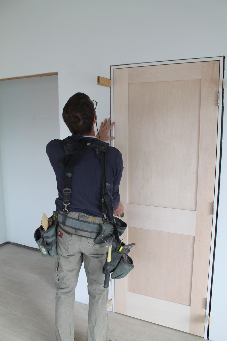 Before nailing the top of the strike jamb, make sure the door slab is hitting the stop evenly.