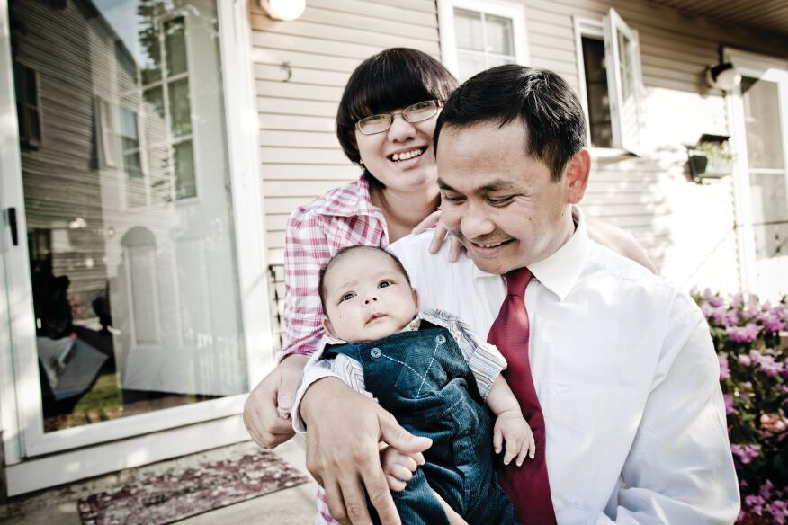 FINALLY ARRIVED: Cambodian-American Tooch Van, wife Chorvy, and son Winston, outside the Lowell, Mass., home they bought with help from a local housing group.