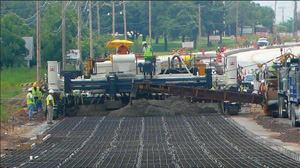 When the weather finally was dry enough to begin the paving on U.S. 377, Sunmount decided to use the new paver for all the Phase 1 paving and try out its quick-change capabilities.
