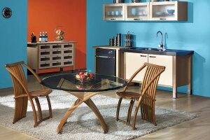 Bold hues and color combinations mark paint manufacturers' newest trend palettes. Here, Sherwin-Williams' Capri and Raucous Orange complement a dining space.