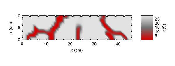 The sensing skin was applied to the beam in the previous photo. This computer image shows the beam's crack pattern in red, which indicates low levels of conductivity. Electrical conductivity is indicated by the gray-to-red color gradient.