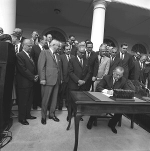 Lyndon B. Johnson signs legislation creating the Department of Housing and Urban Development on Sept. 9, 1965. (Lyndon B. Johnson Presidential Library photo by Donald Stoderl)