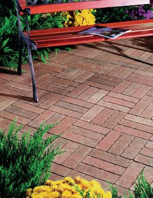 Olde Hanover Prest Brick by Hanover Architectural Products creates the look of aged clay brick pavers reminiscent of European villages. Sides are contoured to enhance the worn, weathered appearance. Each brick is uniform in size for efficient installation; polymeric sand is recommended for joint filling. hanoverpavers.com