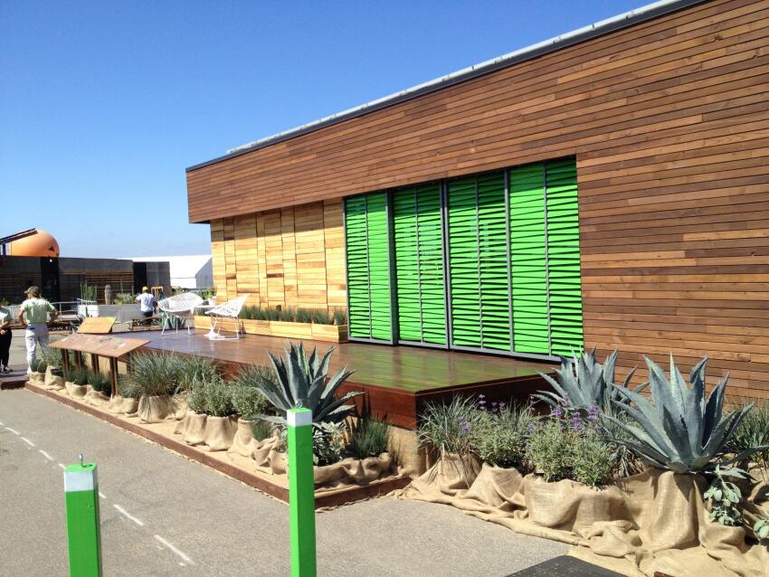 Harvest House features bright green sunshades.