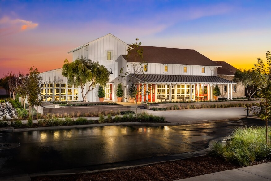 The Ranch House recreation center is the heart of The Cannery community. Designed by Robert Hidey Architects, the building's exterior reflects the agrarian area's farming roots.