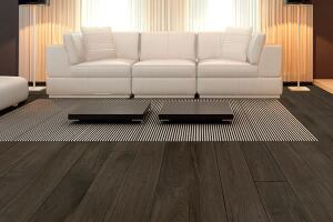 "Engineered wood flooring was once offered in a limited number of wood species, but the durable flooring option has come a long way in terms of style. Charcoal walnut, part of Terra Legno's Annoso Collection, is manufactured through a process that uses younger and smaller trees rather than old-growth hardwoods. The 5""-wide, 9/16""-thick planks have an oil finish. terralegno.com"