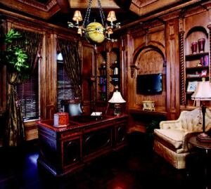 MASCULINE MYSTIQUE: Ornate woodwork, a coffered ceiling, and leather flooring give the study a  stately air.