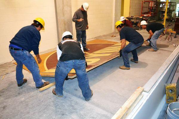 Workers salvaged the maple floor of Alumni Gym, Loyola University