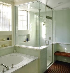 A marble band establishes a water table for this new bath in an old house. Beginning as a lavatory counter, it circles the room as a shelf, window sill, and wall cap.