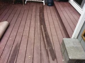 Reflected sunlight from a defective window burned this composite decking.