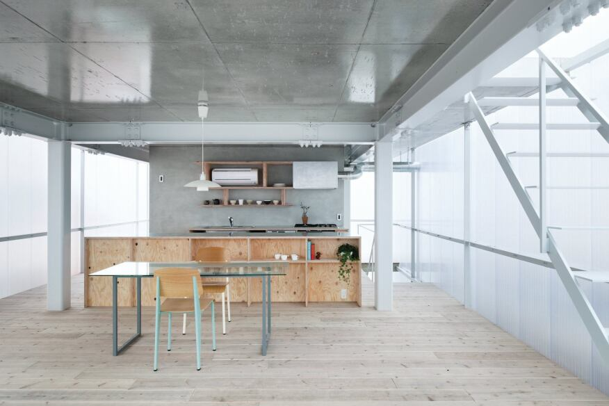 The open kitchen, dining, and living area takes up the majority of the second floor. While views out are obstructed by the translucent walls, the windows can be opened for more direct light and views.