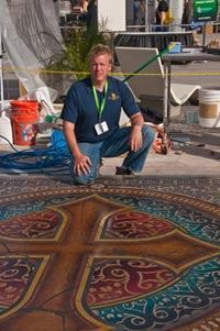 Chris Swanson beside his finished work at the Artistry Demos at World of Concrete.