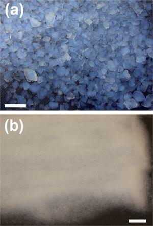 A photograph of the large (a) and small aerogel granules (b).