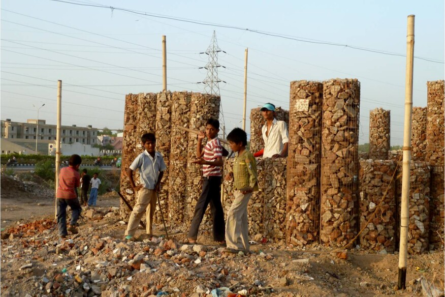 Students help construct the gabion walls of the Patangyu School in Ahmedabad, India.