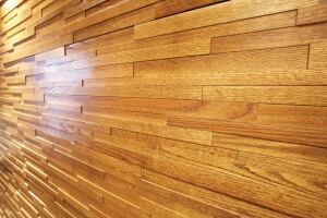 Interwoven Eco-Panels from Architectural Systems provide texture and dimension in a linear wall covering. The interlocking, sustainable wood panels are made from organic, low-emitting walnut, maple, or American oak.