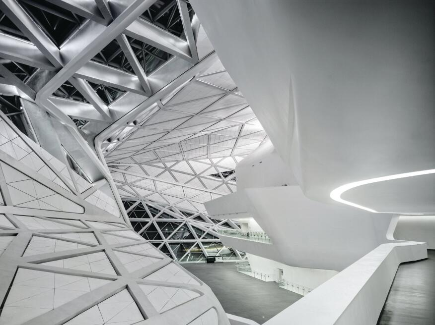 A view from above of the four-story lobby in Zaha Hadid's Guangzhou Opera House in China, whose sinuous shapes were computer-generated.