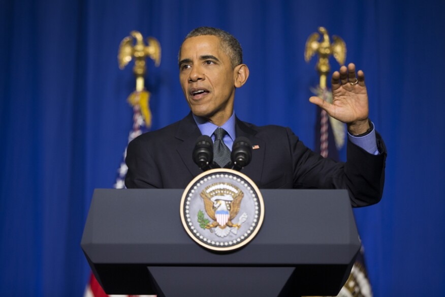 U.S. President Barack Obama speaks at the Organization for Economic Cooperation and Development Centre, in Paris, about the COP21 climate change summit.