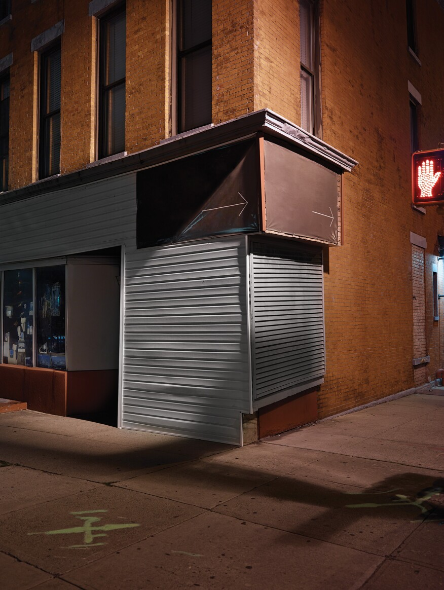 "Corner, Brooklyn, N.Y.""The feeling of three-dimensional space on this corner is emphasized by the single streetlight, which was the main source of illumination. I was told that the building is one Edward Hopper once painted."" -- Lynn Saville"