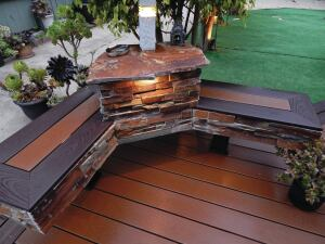 Gary Cherene, owner of Sun Coast Deck, in Redondo Beach, Calif., built this bench from Doug fir lumber and finished it with manufactured stone, Trex boards and lights, and a beautiful slab of sandstone.