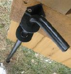 Figure 9. A cane bolt engages a pipe driven into the ground to secure the fixed half of the gate.