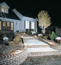 Outdoor and landscape lighting work together to accent and brighten up a home's exterior.