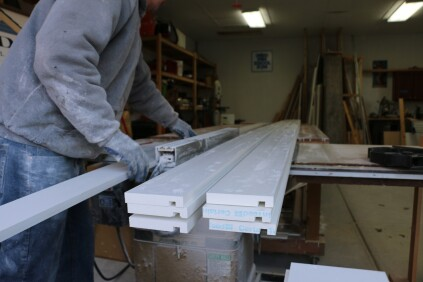 The crew prepares fascia stock by first ripping 1x10s to the proper widths in the shop. They cut a dado 1/2 inch from what will be the bottom of the fascia.