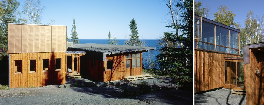 A glass walkway links two distinct structures of this Lake Superior cabin.