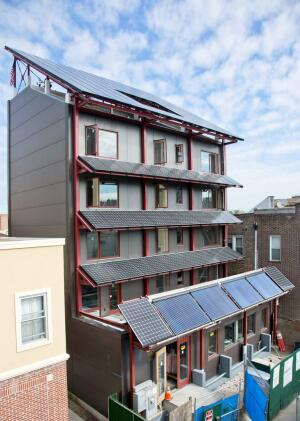 Photovoltaic panels cover the façade of Bright 'n Green, a six-story condominium building in Brooklyn, N.Y.