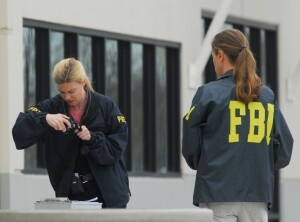 Federal Bureau of Investigations officers photograph documents outside of the Discovery Homes office at 4061 Port Chicago Highway in Concord, Calif., on Thursday Feb. 18, 2010. Federal agents have shut down two Seeno family development companies offices along Port Chicago Road while they execute search warrants. (Susan Tripp Pollard/Staff)