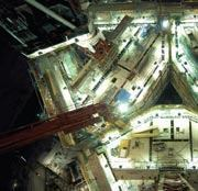This is taken at night from the top of a tower crane showing floor and core wall work in progress.