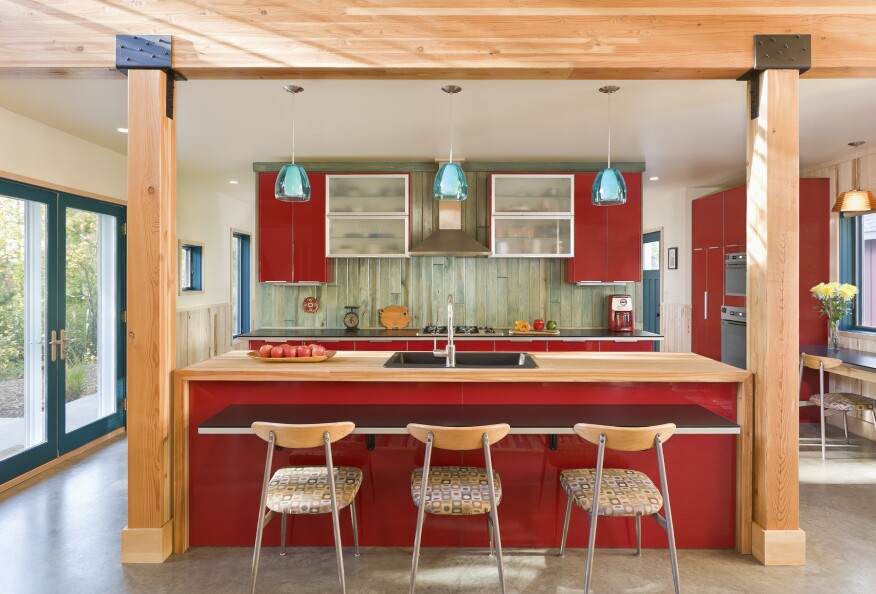 Red cabinetry and subtle blue door frames in this kitchen
