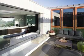 Indoor-Outdoor Bath Makes The Most of Ocean Views