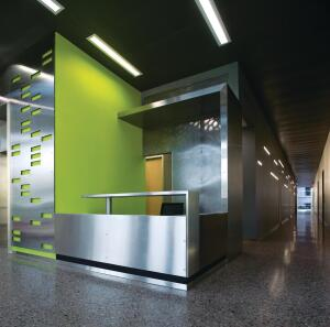 Bold colors highlight vertical circulation elements within the space, and open fire stairs encourage building occupants to forego the elevators.