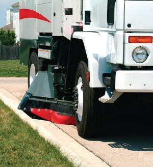 Waterless sweepers feature enclosed brooms. The learning curve typically is short for operators to become accustomed to cleaning curblines without side broom visibility. Photo: Elgin Sweeper Co.