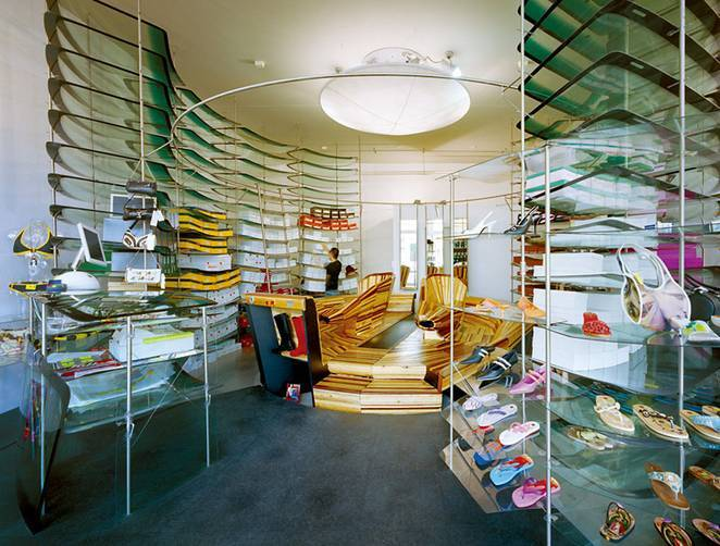 A Shoe Shop Interior Designed With Recycled Car Windshields