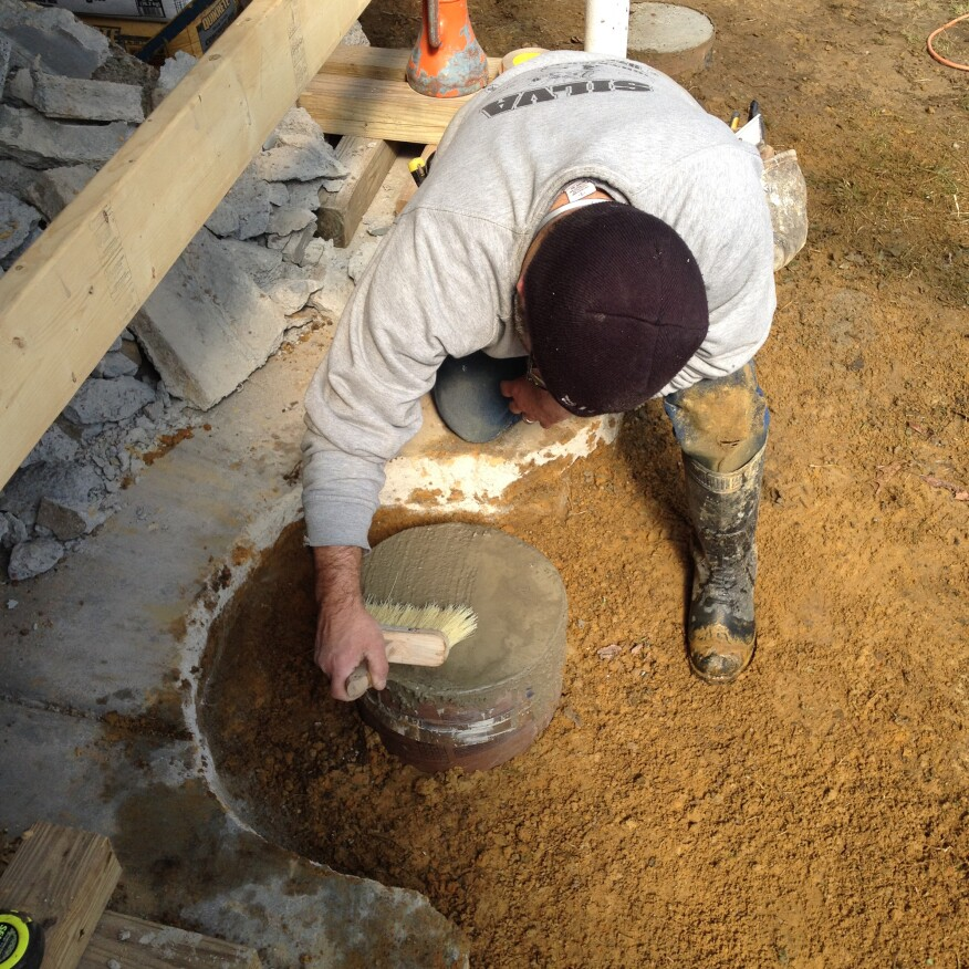 When the form was filled, the rest of the hole was backfilled and a broom finish was put on the top of the concrete.