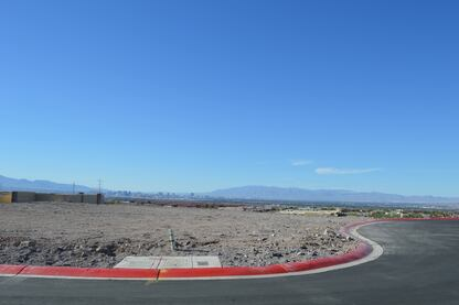 The 0.26-acre lot in the Sky Terrace subdivision overlooks the Las Vegas strip.