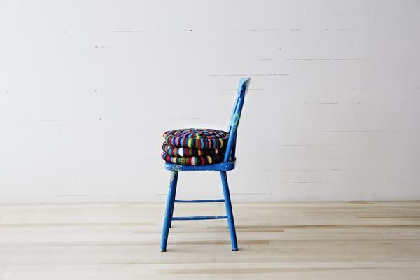 Local design studioThe Guild hand-wove its colorful wool Snake Cushion.
