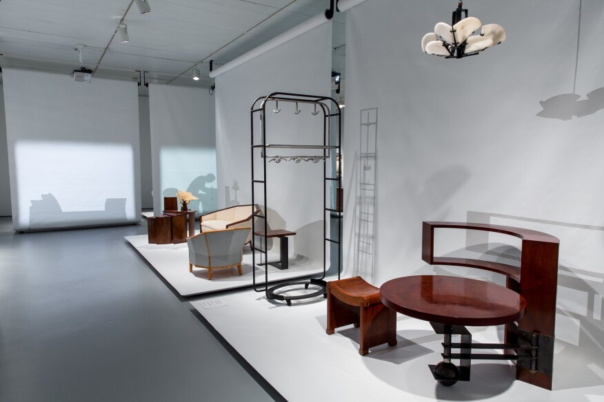View of the exhibition showing a table/bookcase designed by Chareau (c.1930)