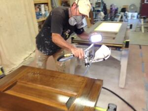 Todd applies clear finish on gel stained custom fir doors.