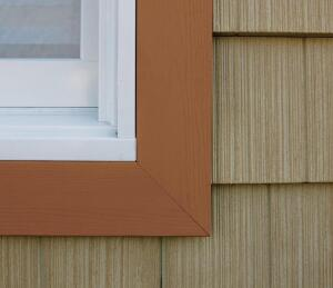 """IQm Trim, a division of the Tapco Group, now offers three new profiles of its color-through cellular PVC trim: 8"""" fascia board, brick mold with J-channel, and J-channel with integrated nailing flange. With 17 colors available and a wood-grain finish, IQm matches the colors from fiber cement and vinyl siding makers, and adds contrast with shades such as Vermont green and butterscotch. The trim offers speedier installations and hides end cuts, excessive caulking, and imperfect miter cuts. All IQm products come packaged in a clear film to protect against damage during installation. IQmTrim.com"""