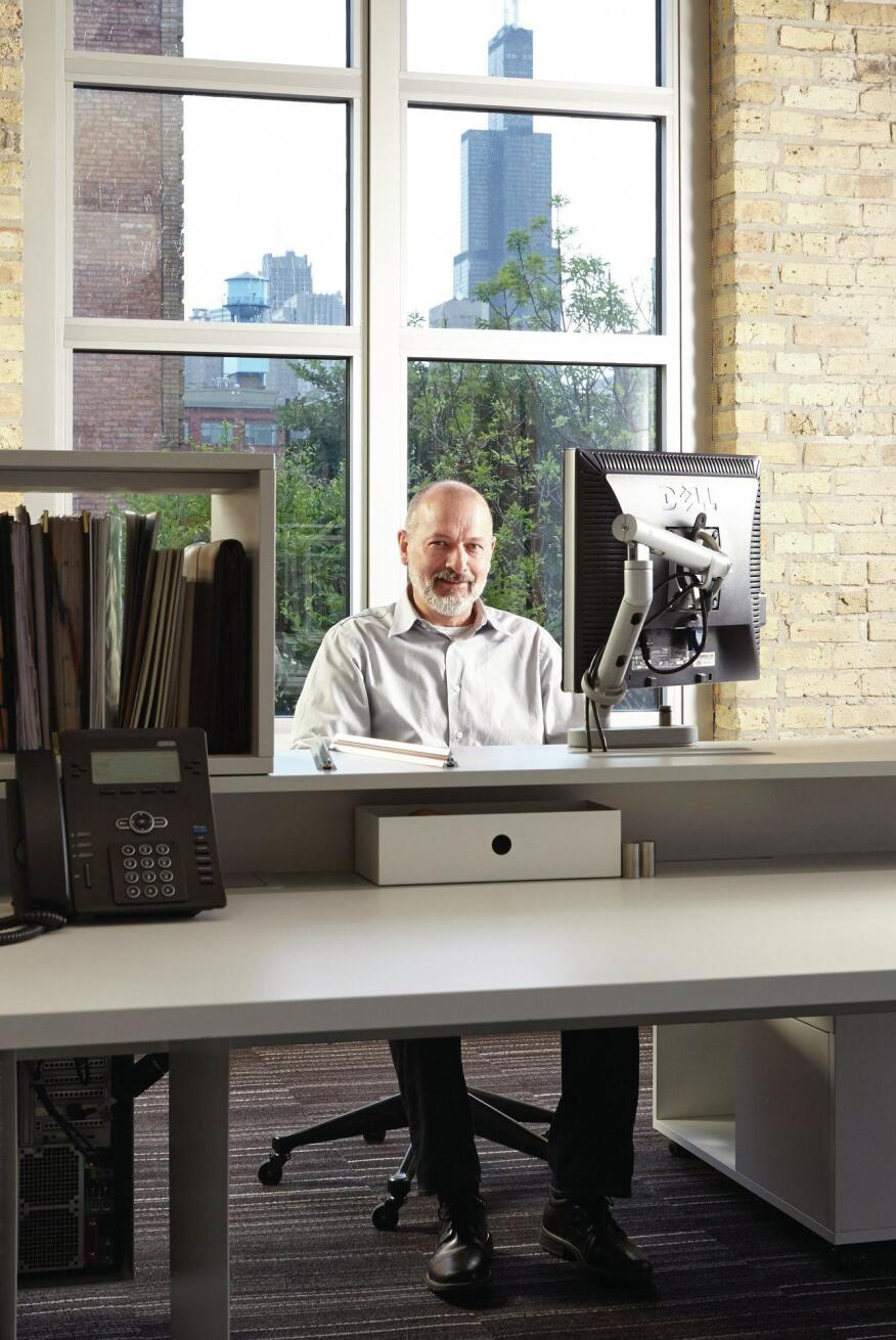 The office has a view of the famed Willis Tower, visible behind David Brininstool's desk.