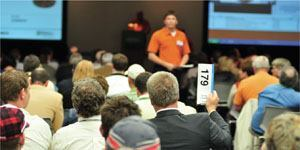 The annual CIM Auction held at World of Concrete raised $386,000, nearly $100,000 more than last year's event.