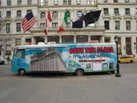 "FINAL PLEA: To stop the conversion, a New Yorker drives a 34-foot RV imploring people to ""Save the Plaza!"""