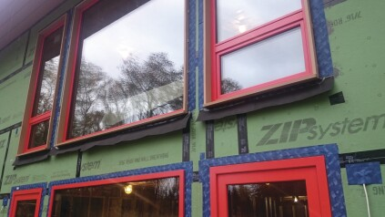 Strips of building paper that will be integrated with the building-paper drainage plane provide additional protection for thewindow sills.