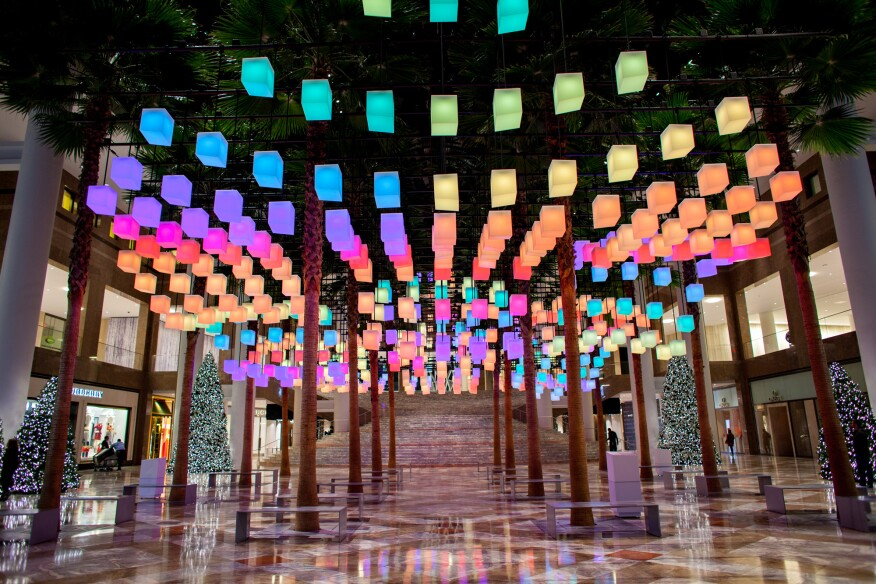 A view of the installation Luminaries looking toward the grand stair in the Winter Garden.