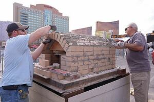 Attendees learned how to construct a masonry heater and outdoor pizza oven at the Masonry Heater Showcase.